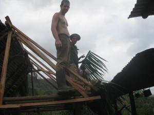 Me, helping build a thatched roof